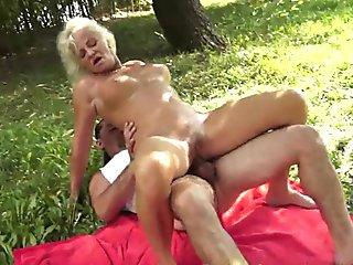 Facialized grandma gets fucked outdoors
