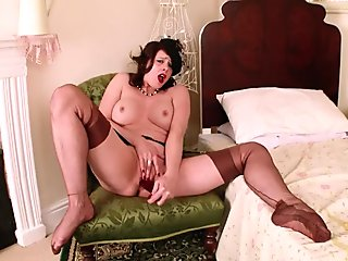 Hot Milf Karina Currie dildos toy to orgasm in stockings and suspenders