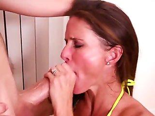 Slutty cougar strokes and sucks